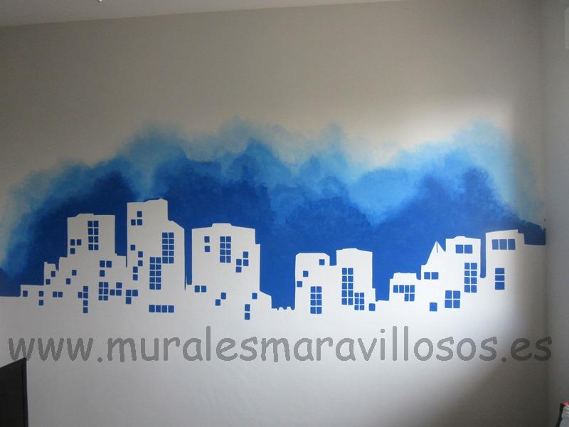 skyline mural pintado en pared tonos azules edificios